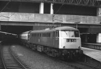The 10.27 Manchester Piccadilly - London Euston stands in the concrete cavern that is Birmingham New Street station on 1 November 1969. Class 85 AC electric locomotive no E3090 is in charge. <br><br>[Bill Jamieson&nbsp;01/11/1969]