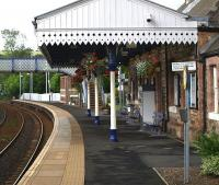 The up platform at Aberdour on 15th July 2010. The hanging baskets are a treat. <br> <br><br>[Brian Forbes 15/07/2010]