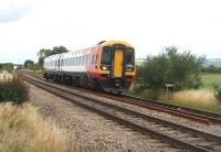 South West Trains 158890 comes off the long straight section south of Aschurch heading for Cheltenham and the South Coast. The train is aproaching the AHB level crossing at Tredington and the sweeping curve to the south of this location.<br><br>[Mark Bartlett&nbsp;17/07/2010]