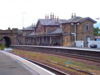 The main station building at Cupar. View across the lines from the southbound platform on 18 July. The A914 crosses the railway on the bridge in the left background.<br><br>[Andrew Wilson&nbsp;18/07/2010]