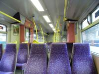 You've only a matter of months now to appreciate the kindegarten <br> colour scheme of a Class 322 interior, seen here in July 2010.� Only 5 of the class were ever built and all are operating on the North Berwick and Dunbar routes.� Come March 2011 they'll return south from whence they came, and be replaced by new Class 380s, of which none has so far been delivered.� <br>  <br> <br><br>[David Panton&nbsp;14/07/2010]