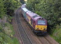 67021 nears Aberdour with a Leuchars - Edinburgh <I>Golflink</I> special on 18 July 2010.<br> <br><br>[Bill Roberton&nbsp;18/07/2010]