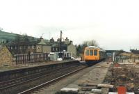 Reopening works taking place at Cononley Station, near Skipton, in 1988 as a first generation DMU heads towards Leeds. Note the crossing cabin at the end of the platform to the left of the DMU. Originally opened in 1847, Cononley station closed to passengers in 1965 but was reopened on 20 April 1988, less than a month after this photograph was taken.<br><br>[David Pesterfield&nbsp;22/03/1988]