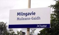 Scotrail is keen to render celtic-based placenames into Gaelic on <br> bilingual station signs.  Milngavie is from the gaelic for, apparently, either windmill or Gavin's mill.  I've no problem with Muillean (mill) but there doesn't seem to be such a word as 'Gaidh'.  Is this just an attempt to render 'guy' into Gaelic to tie in with the pronunciation? Photographed on 14 July 2010.<br> <br><br>[David Panton&nbsp;14/07/2010]