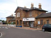 The main station building at Cupar, complete with its impressive floral arrangements, seen here looking north from the car park on 18 July 2010.  <br><br>[Andrew Wilson&nbsp;18/07/2010]