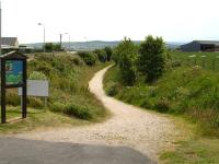 Start of the section of Moray cycle track heading east along the former trackbed towards Cullen, seen from the A942 on the south edge of Portknockie in June 2010.<br><br>[David Pesterfield&nbsp;26/06/2010]