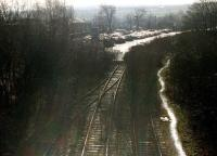 The closed and overgrown Spen Valley line at Cleckheaton looking south on 14 February 1997. The track has been truncated to make way for a car park extension to the Tesco supermarket in the left background.<br><br>[David Pesterfield&nbsp;14/02/1997]
