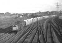 Clayton D8614 comes off the line from Niddrie North at Portobello�East Junction in February 1970 with empty Leith General Warehousing grain wagons�returning from the North British Distillery at Gorgie to Leith. This�and the outward working were amongst the highlights of an afternoon's�photography on the Sub around that time. <br><br>[Bill Jamieson&nbsp;25/02/1970]