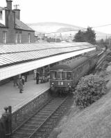 Looking north over Peebles station as the 2.16pm DMU arrival from Edinburgh, ultimate destination Galashiels,  draws to a halt at the single platform on 3 February 1962, the last day of passenger services on the line.<br> <br><br>[Frank Spaven Collection (Courtesy David Spaven)&nbsp;03/02/1962]