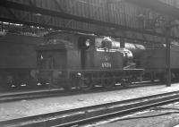 J72 0-6-0 no 69016 standing inside Heaton shed, thought to be on 11 April 1964.<br><br>[K A Gray&nbsp;11/04/1964]