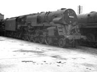 Crosti-boilered BR Standard class 9F no 92020, sporting a 15A shed plate, on its home shed at Wellingborough around 1960 - obviously in course of 'receiving attention'. <br><br>[K A Gray&nbsp;//]