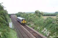 A Cumbrian Coast service passes under the Carnforth Ironworks Tramroad bridge that is now used to carry a private farm road [See image 30144]. 153378 is running between Silverdale and Carnforth.<br><br>[Mark Bartlett&nbsp;26/06/2010]