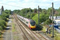 A southbound Virgin Pendolino, bound for London Euston, passes Coppull on 16 July 2010. The emergency crossovers have been removed from this location since my last visit in early 2009.<br><br>[John McIntyre&nbsp;16/07/2010]