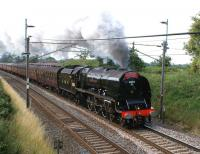Ex-LMS <I>Coronation</I> Pacific no 6233 <i>Duchess of Sutherland</i> heads north on the WCML on 24 July 2010 with the <I>Cumbrian Mountain Express</I> from Liverpool to Carlisle. The train has just restarted from Barton Down Loop, having been held to allow passage of a northbound Pendolino.<br><br>[John McIntyre&nbsp;24/07/2010]