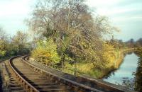 The Balerno branch - seen here crossing the Union Canal looking towards Balerno Junction - lost its passenger services in 1943, but freight would survive for another three years after this photograph was taken on 2nd November 1964. Much of the route is now an attractive walkway following the densely wooded valley of the Water of Leith.<br><br>[Frank Spaven Collection (Courtesy David Spaven)&nbsp;02/11/1964]