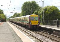A Glasgow - bound EMU arrives at Glengarnock on 25 July 2010 [see image 25334 for the view from the same spot forty seven years earlier].<br><br>[Colin Miller&nbsp;25/07/2010]