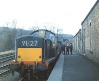 The last freight to visit Penicuik [closed to passengers in September 1951]. D8561 photographed at the platform of the Midlothian terminus during the early days of April 1967. In the background is the short tunnel under the A701 that once provided a rail link to Bank Mill [see image 34469]. <br><br>[Jim Peebles&nbsp;/04/1967]