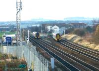 Passing 158s at Saughton in December 2002. On the left a train from Dunblane is approaching, while on the right Fife Circle train turns north towards the Forth Bridge.<br><br>[John Furnevel&nbsp;11/12/2002]