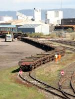 Unloading a pipe train in Leith South yard, north sidings, in April 2005.<br><br>[John Furnevel&nbsp;11/04/2005]