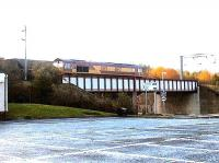 Westbound coal train passing through Wester Hailes station, 2002.<br><br>[John Furnevel&nbsp;//2002]