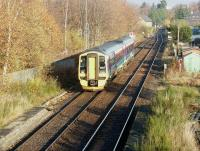 Morning train from Kyle to Inverness arriving at Muir of Ord in November 2003.<br><br>[John Furnevel&nbsp;23/11/2003]