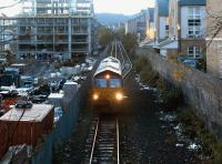 An EWS class 66 locomotive arriving at Powderhall in October 2004 to pick up the early morning Binliner for Oxwellmains.<br><br>[John Furnevel&nbsp;18/10/2004]