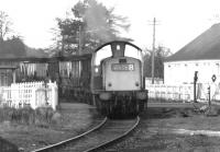 A coal train from Dollar passing over the A908 level crossing and about to run through the abandoned platforms of the former Tillicoultry station in the autumn of 1971. The train is on its way to the yards at Alloa with coal for Kincardine power station. [See image 18238]<br><br>[John Furnevel&nbsp;07/10/1971]