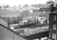 After leaving the Glasgow - Edinburgh main line at Haymarket West Junction, a class 37 brings a southbound freight past the signal box at Gorgie Junction in May 1975.<br><br>[John Furnevel&nbsp;27/05/1975]
