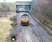 A class 66 heading back to Millerhill Yard light engine slows on the approach to Niddrie South junction on 10 December 2002.<br><br>[John Furnevel&nbsp;10/12/2002]
