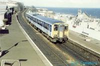 Looking north over Kinghorn Station with a southbound sprinter and the North Sea in the background.<br><br>[Ewan Crawford&nbsp;//]