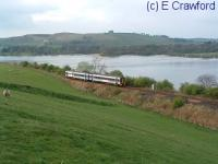 A southbound train passing Lindores Loch.<br><br>[Ewan Crawford&nbsp;//]