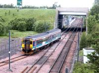 A train leaving the new reversing siding at the north end of Millerhill yard for Newcraighall station (under the bridge) to commence a Newcraighall - Dunblane service on 4 June 2002, the opening day of passenger services between Newcraighall and Edinburgh Waverley.<br><br>[John Furnevel&nbsp;04/06/2002]