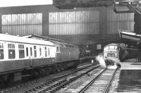 An unidentified Brush Type 4 arriving at Carlisle platform 4 from the north on 13 June 1970. Standing at platform 3 is 'Peak' D183, preparing to leave with the 1025 Leeds - Glasgow Central.<br><br>[John Furnevel&nbsp;13/06/1970]