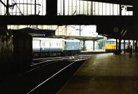 Looking south through Carlisle station in July 1976 as an up WCML train calls at platform 4 behind a class 86 locomotive, while another waits on the centre road.<br><br>[John Furnevel&nbsp;14/07/1976]
