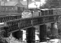 D224 crossing the River Caldew at Dentonholme on the Carlisle goods lines with an up freight in December 1968. The Dentonholme goods depot shunter stands in the background. [See image 14716]<br><br>[John Furnevel&nbsp;08/12/1968]