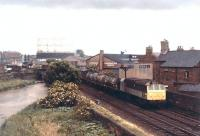 With the Rome Street Gasometer in the background D7547 hauls a northbound freight on the Carlisle goods lines on 2 July 1969. <br><br>[John Furnevel&nbsp;02/07/1969]