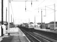 A class 47 southbound through Coatbridge Central in August 1981. The train is the 10.18 Perth - Motherwell with vans attached destined for Manchester.<br><br>[John Furnevel&nbsp;24/08/1981]