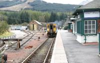 An Oban - Glasgow train at Crianlarich in April 2005 awaiting the arrival of the service from Fort William before proceeding south as one.<br><br>[John Furnevel&nbsp;16/04/2005]