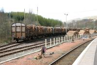 View north at Crianlarich in April 2005, with timber loading operations taking place in the sidings running along the west side of the station.<br><br>[John Furnevel&nbsp;16/04/2005]