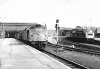 A pair of Type 2s 5320+5121 recently arrived at Perth with an Inverness - Edinburgh train on 25 May 1970. Over on the Dundee platforms EE Type 4 260 prepares to depart with an Aberdeen - Glasgow working.<br><br>[John Furnevel&nbsp;25/05/1970]