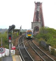 A train from Edinburgh comes off the Forth Bridge in April 2005 and is about to enter North Queensferry station.<br><br>[John Furnevel&nbsp;28/04/2005]