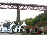 A northbound train passing over the 'Hawes Inn' on the southern approach to the Forth Bridge on 30 April 2005.<br><br>[John Furnevel&nbsp;30/04/2005]