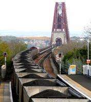 A coal train from Hunterston approaching the Forth Bridge in April 2005 after passing through Dalmeny Station with coal for Longannet.<br><br>[John Furnevel&nbsp;30/04/2005]