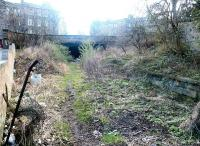 Looking south at the overgrown remains of Heriothill goods and the tunnel under Rodney Street/Broughton Road which originally took the Edinburgh, Leith & Newhaven through to Scotland Street and, ultimately, Canal Street. March 2003. <br><br>[John Furnevel&nbsp;10/03/2003]