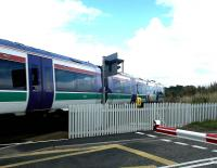 An Aberdeen - Inverness train at speed (and how) over Kinloss level crossing in September 2004.<br><br>[John Furnevel&nbsp;12/09/2004]