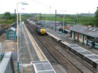 An up ECML express runs south through Alnmouth station during refurbishment works in May 2004.<br><br>[John Furnevel&nbsp;26/05/2004]