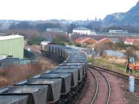 Westbound coal empties coming off the line from Millerhill yard at Niddrie West Junction on 21 February 2003 behind an unidentified EWS class 66 locomotive. <br><br>[John Furnevel&nbsp;21/02/2003]