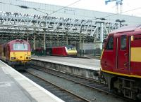 General view across the platforms at the east end of Waverley on 19 July 2004. Standing between the two stabled Sleeper locomotives is DVT 82120, about to leave with a train for North Berwick.<br><br>[John Furnevel&nbsp;19/07/2004]