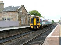 Platform view looking east at Linlithgow in May 2005 as a train for Edinburgh leaves the station.<br><br>[John Furnevel&nbsp;11/05/2005]
