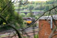 A coal train being loaded (by JCBs) at the collection and loading point on the south to west curve just north of Inverkeithing Station in May 2005.<br><br>[John Furnevel&nbsp;11/05/2005]